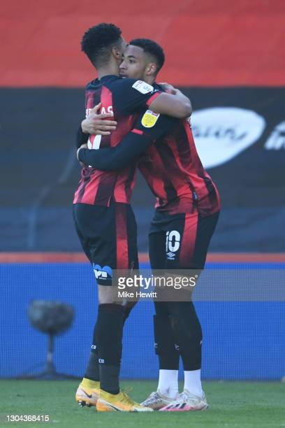 Arnaut Danjuma of AFC Bournemouth celebrates with teammate Junior Stanislas after scoring his team's first goal during the Sky Bet Championship match...