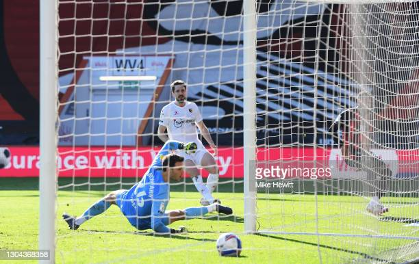 Arnaut Danjuma of AFC Bournemouth scores his team's first goal past Daniel Bachmann of Watford during the Sky Bet Championship match between AFC...