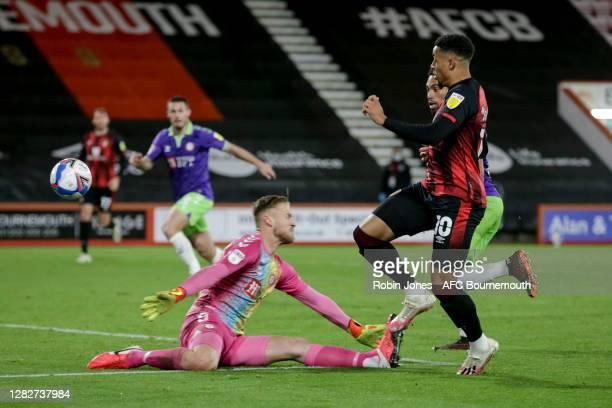 Arnaut Danjuma of Bournemouth beats Daniel Bentley of Bristol City and scores a goal to make it 10 during the Sky Bet Championship match between AFC...
