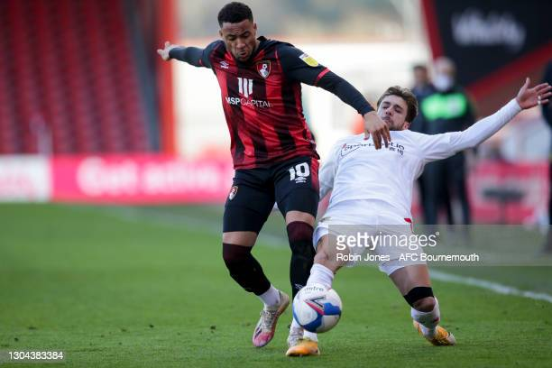 Arnaut Danjuma of Bournemouth beats Kiko Femenia of Watford to the ball during the Sky Bet Championship match between AFC Bournemouth and Watford at...