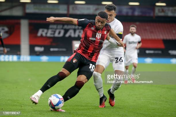 Arnaut Danjuma of Bournemouth holds off Lee Buchanan of Derby County during the Sky Bet Championship match between AFC Bournemouth and Derby County...
