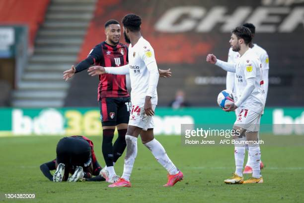 Arnaut Danjuma of Bournemouth stands between Nathaniel Chalobah of Watford and Jefferson Lerma of Bournemouth after Chalobah fouls Lerma for the...