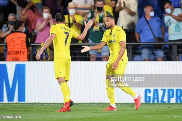 Arnaut Danjuma of Villarreal celebrates with teammate Gerard Moreno after scoring their side's second goal during the UEFA Champions League group F...