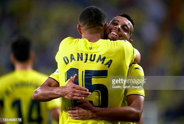 Arnaut Danjuma of Villarreal CF celebrates after scoring his team's first goal with his teammate Francis Coquelin during the La Liga Santander match...