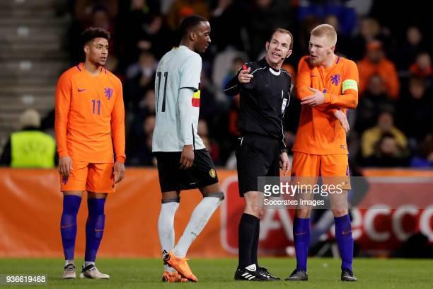 Arnaut Groeneveld of Holland U21 Dodi Lukebakio Ngandoli of Belgium U21 referee Marco Fritz Rick van Drongelen of Holland U21 during the match...