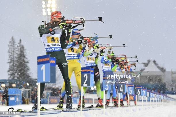 TOPSHOT Arnd Peiffer of Germany and Martin Ponsiluoma of Sweden compete in the men's 4x75 km relay event at the IBU World Biathlon Championships in...