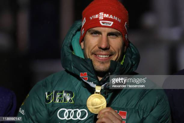 Arnd Peiffer of Germany celebrates celebrates winning the Gold medal at the Medal Ceremony for the IBU Biathlon World Championships Men's 20km at...