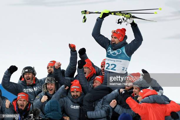 Arnd Peiffer of Germany celebrates winning the gold medal after the victory ceremony for the Men's 10km Sprint Biathlon on day two of the PyeongChang...