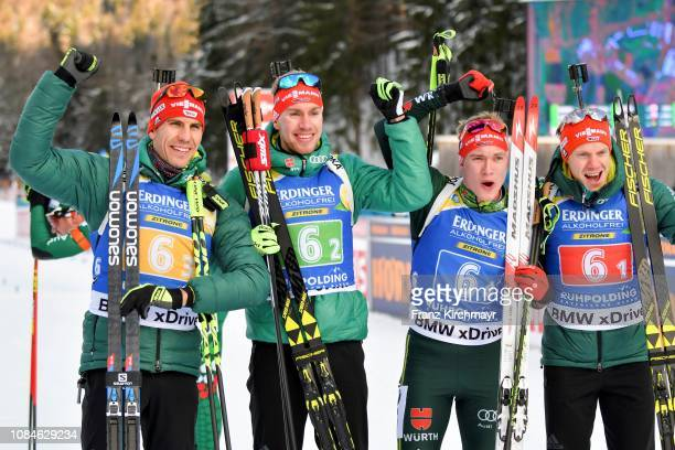Arnd Peiffer of Germany celebrates with his team mates Johannes Kuehn, Benedikt Doll and Roman Rees after the Men 4x7.5 km Relay during the IBU...