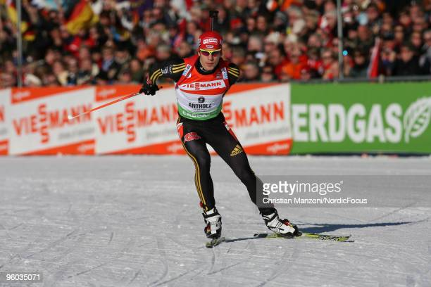 Arnd Peiffer of Germany skis on his way to victory during the men's sprint in the e.on Ruhrgas IBU Biathlon World Cup on January 23, 2010 in...