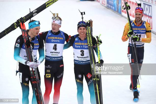 Arnd Peiffer of Germany walks away whilst Emilien Jacquelin of France L and 2nd place), Johannes Thingnes Boe of Norway and Quentin Fillon Maillet of...