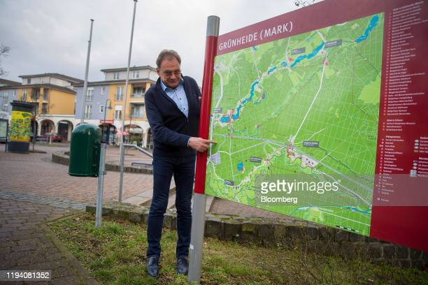 Arne Christiani, mayor of Guenheide, poses for a photograph beside a map in Gruenheide, Germany, on Monday, Jan. 13, 2020. Elon Musk is taking his...