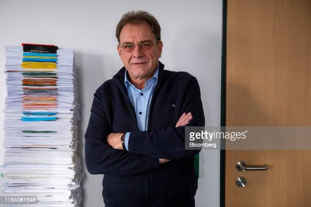 Arne Christiani, mayor of Guenheide, poses for a photograph in his office at the town hall in Gruenheide, Germany, on Monday, Jan. 13, 2020. Elon...