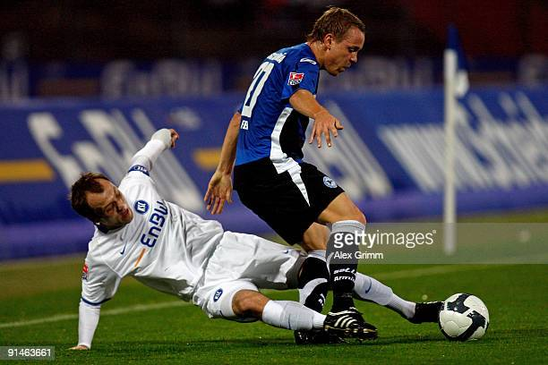 Arne Feick of Bielefeld is challenged by Alexander Iashvili of Karlsruhe during the Second Bundesliga match between Karlsruher SC and Arminia...