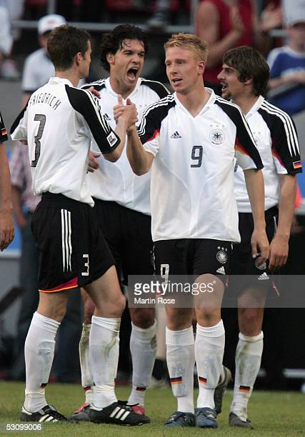 Arne Friedrich Michael Ballack Mike Hanke and Sebastian Deisler of Germany celebrate the third goal during the FIFA Confederations Cup match between...