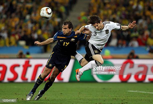 Arne Friedrich of Germany and Richard Garcia of Australia battle for a header during the 2010 FIFA World Cup South Africa Group D match between...