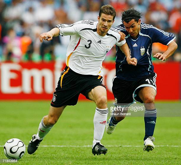 Arne Friedrich of Germany attempts to hold off the challenge of Carlos Tevez of Argentina during the FIFA World Cup Germany 2006 Quarterfinal match...