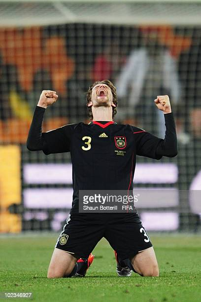 Arne Friedrich of Germany celebrates after the 2010 FIFA World Cup South Africa Group D match between Ghana and Germany at Soccer City Stadium on...
