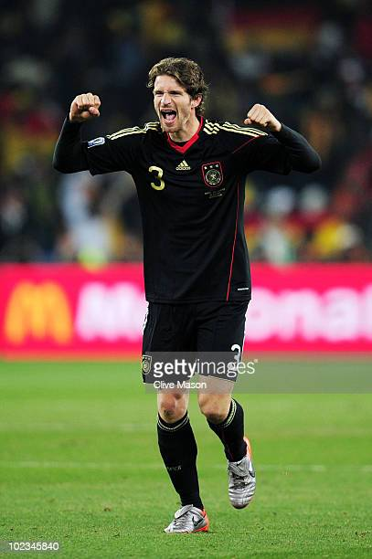 Arne Friedrich of Germany celebrates victory after the 2010 FIFA World Cup South Africa Group D match between Ghana and Germany at Soccer City...