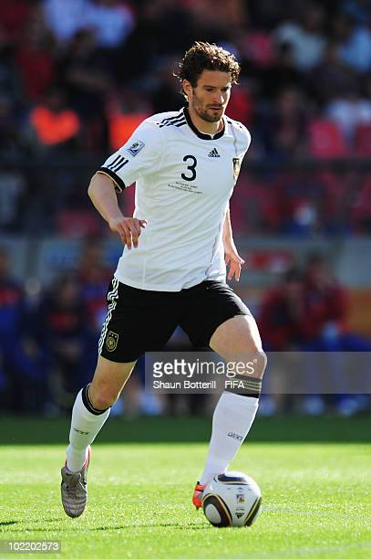 Arne Friedrich of Germany runs with the ball during the 2010 FIFA World Cup South Africa Group D match between Germany and Serbia at Nelson Mandela...
