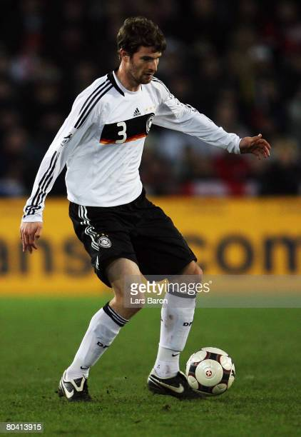 Arne Friedrich of Germany runs with the ball during the international friendly match between Switzerland and Germany at the St JakobPark on March 26...