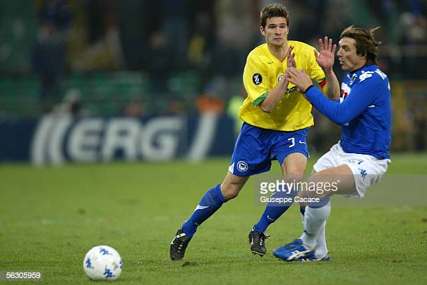 Arne Friedrich of Hertha BSC Berlin fight for the ball with Vitali Kutuzov of Sampdoria during the UEFA Cup group C match between Sampdoria Genoa and...