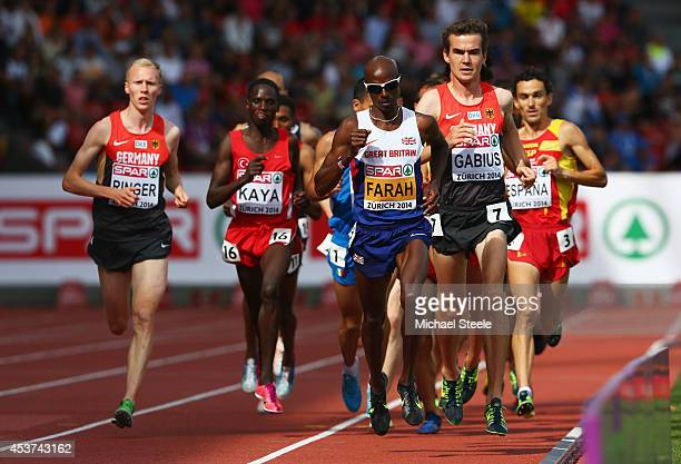 Arne Gabius of Germany and Mo Farah of Great Britain and Northern Ireland lead the pack as they compete in the Men's 5000 metres final during day six...