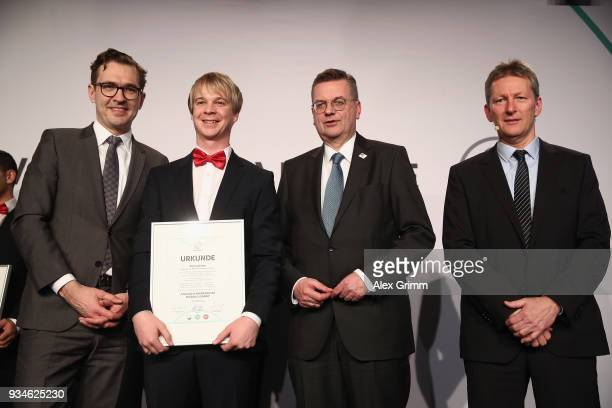 Arne Janssen poses with DFB Secretary General Friedrich Curtius DFB President Reinhard Grindel and Frank Wormuth after receiving his certificate...