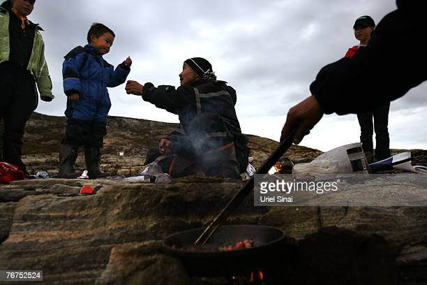Arne Lange a 39yearold Inuit fisherman and his family have a family seal barbeque August 26 2007 on an island near their home village of Ilimanaq...