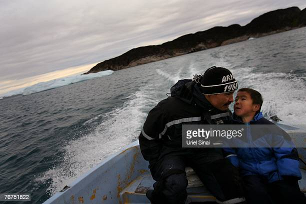 Arne Lange a 39yearold Inuit fisherman and his fiveyearsold son Angut Rosbach as they sail on their way to hunt seals August 26 2007 near their home...