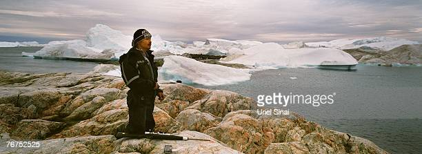 Arne Lange a 39yearold Inuit fisherman looks for seals from an island August 26 2007 near his home town of Ilimanaq Greenland Lange who has largely...