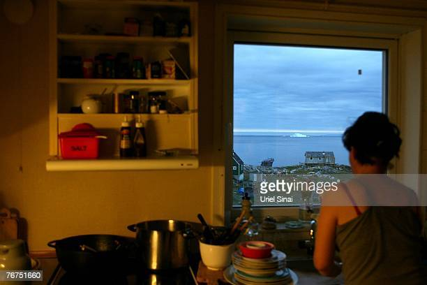 Arne Lange's wife Martha Rosbach washes the dishes August 26 2007 in Ilimanaq Greenland Her husband Arne Langa a 39yearold Inuit fisherman who has...