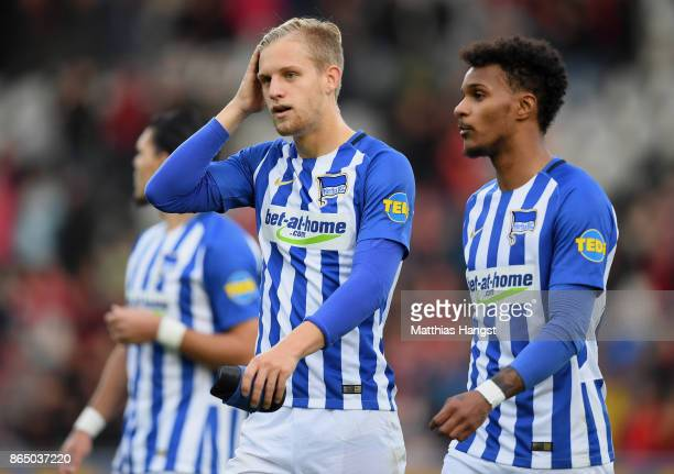 Arne Maier and Valentino Lazaro of Berlin show their disappointment after the Bundesliga match between SportClub Freiburg and Hertha BSC at...