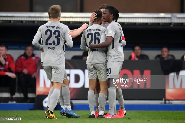 Arne Maier Matheus Cunha and Dedryck Boyata of Hertha BSC celebrate after scoring the 12 during the game between the SC Paderborn 07 against Hertha...