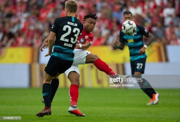 Arne Maier of Berlin and Pierre Kunde Malong of Mainz battle for the ball during the Bundesliga match between 1 FSV Mainz 05 and Hertha BSC at Opel...