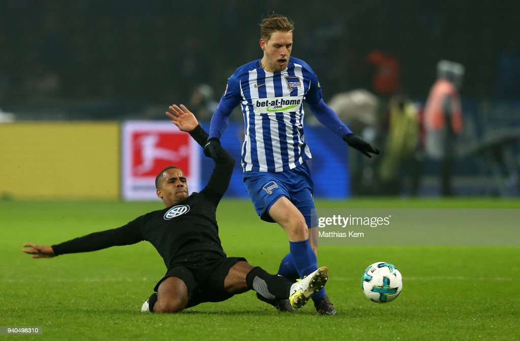 Arne Maier (R) of Berlin battles for the ball with Jeffrey Bruma of Wolfsburg during the Bundesliga match between Hertha BSC and VFL Wolfsburg at Olympiastadion on March 31, 2018 in Berlin, Germany.