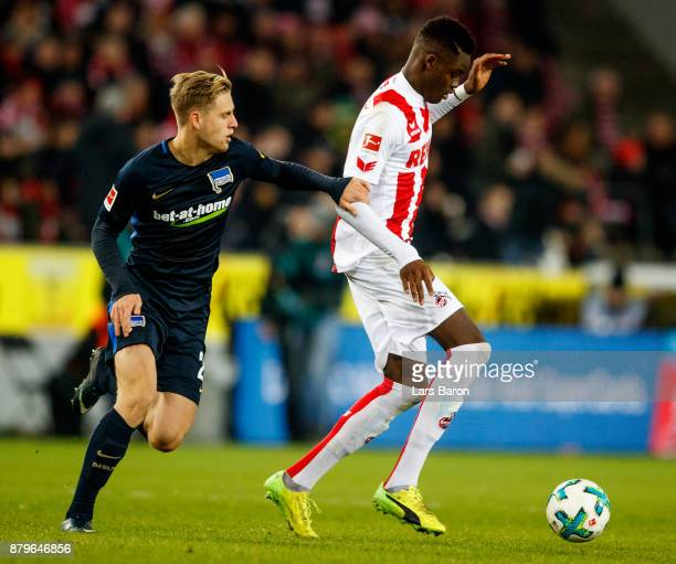 Arne Maier of Berlin challenges Yann Aurel Bisseck of Koeln during the Bundesliga match between 1 FC Koeln and Hertha BSC at RheinEnergieStadion on...