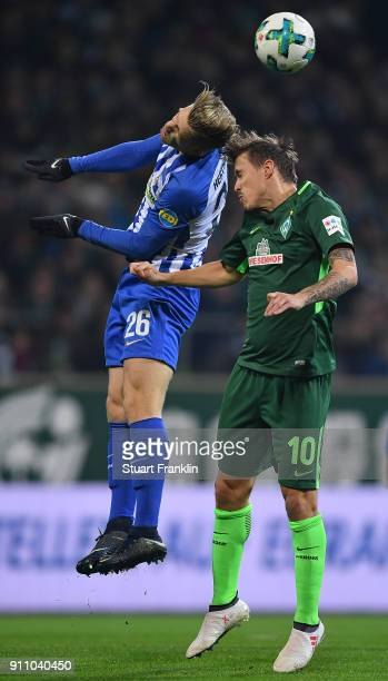 Arne Maier of Berlin fights for the ball with Max Kruse of Bremen during the Bundesliga match between SV Werder Bremen and Hertha BSC at Weserstadion...