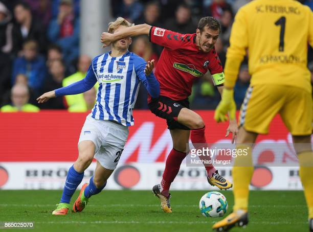 Arne Maier of Berlin is fouled for a penalty by Julian Schuster of Freiburg during the Bundesliga match between SportClub Freiburg and Hertha BSC at...