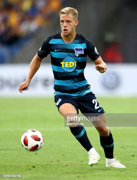 Arne Maier of Berlin runs with the ball during the DFB Cup first round match between Eintracht Braunschweig and Hertha BSC at Eintracht Stadion on...