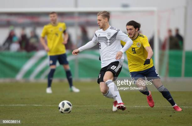 Arne Maier of Germany and Fraser Hornby of Scotland fight for the ball during the Under 19 Euro Qualifier between Germany and Scotland on March 21...