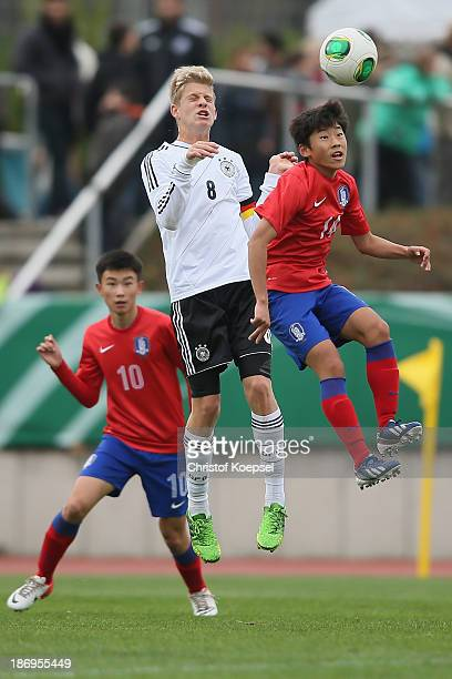 Arne Maier of Germany and Son Won Gil of South Korea go up for a header during the U15 international friendly match between Germany and South Korea...