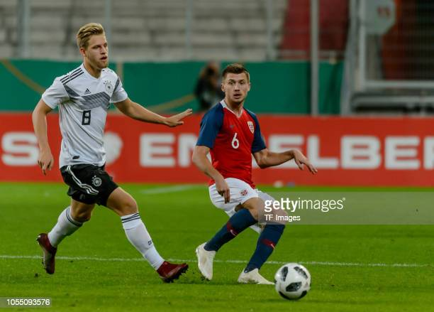 Arne Maier of Germany and Vebjoern Hoff of Norway battle for the ball during the 2019 UEFA Under21 European Championship Qualifier match between U21...