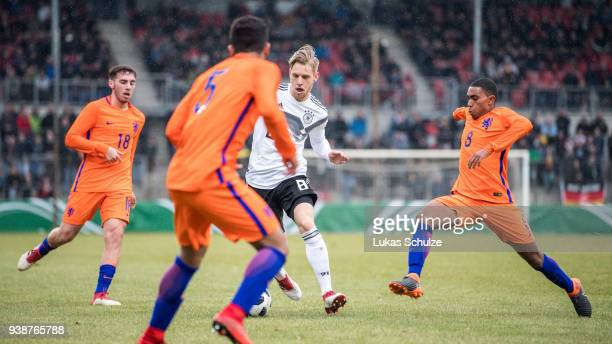 Arne Maier of Germany Deroy D'Encarnacao Duarte ans Orkun Koekcue of Netherlands in action during the Under 19 Euro Qualifier between Germany and...