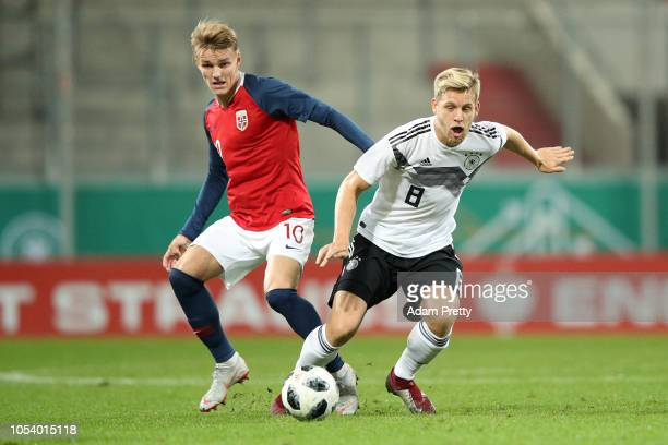 Arne Maier of Germany holds off Martin Ødegaard of Norway during the 2019 UEFA Under 21 European Championship Qualifier between Germany U21 and...
