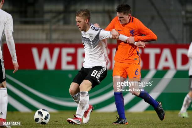 Arne Maier of Germany U19 Tommie van de Looi of Holland U19 during the match between Holland U19 v Germany U19 at the Wersestadium on March 27 2018...