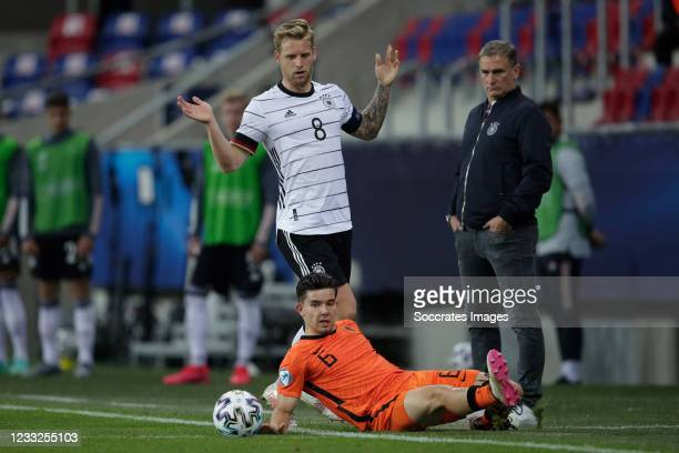 Arne Maier of Germany U21, Justin Kluivert of Holland during the EURO U21 match between Holland v Germany at the Mol Arena Sosto on June 3, 2021 in...