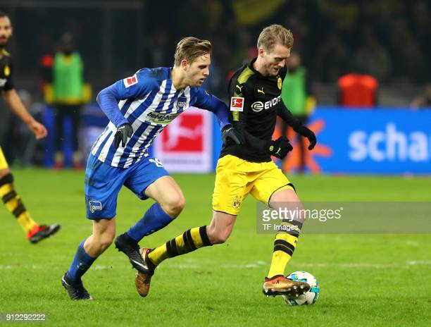 Arne Maier of Hertha and Andre Schuerrle of Dortmund battle for the ball during the Bundesliga match between Hertha BSC and Borussia Dortmund at...
