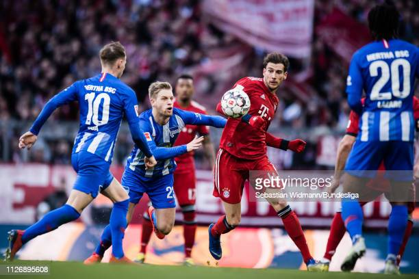 Arne Maier of Hertha Berlin and Leon Goretzka of Bayern Munich compete for the ball during the Bundesliga match between FC Bayern Muenchen and Hertha...