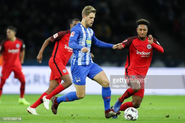 Arne Maier of Hertha Berlin battles for possession with Jonathan de Guzman of Eintracht Frankfurt during the Bundesliga match between Hertha BSC and...